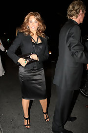 Raquel Welch was spotted leaving a party at the Mondrian Hotel wearing a black satin halter dress topped with a cropped blazer.