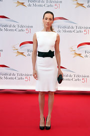 Maggie Q went for a sleek modern look with a white boatneck sheath cinched with a bow-embellished black belt when she attended the Television Festival in Monte Carlo.