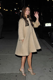 Nikki Reed channeled the '60s in a lovely textured sand swing coat with cropped sleeves.