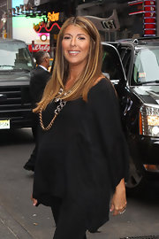 Nina Garcia wore a simple yet elegant black maternity caftan to the 'Project Runway' fashion show.