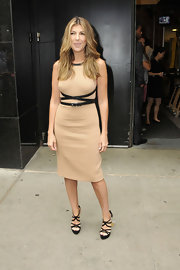 Project Runway judge, Nina Garcia joined Heidi Klum and Michael Kors on the set of Good Morning America. Marie Claire's fashion editor opted for a sleek nude sheath dress with a black leather wrap-around belt. Nina donned a center part in her waves and stepped out in black platform sandals.