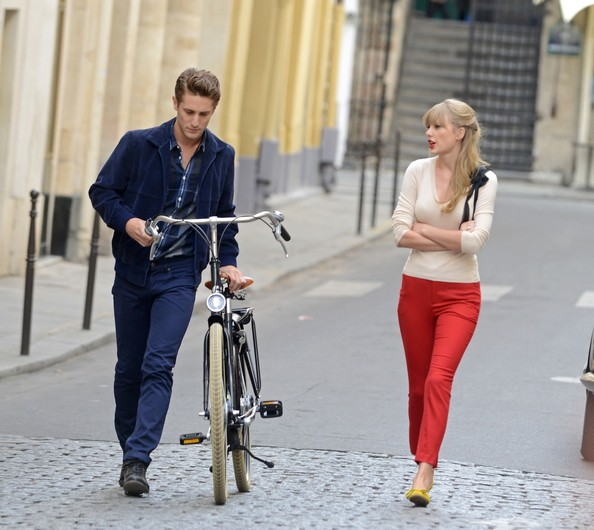 OH LA LA!! Sexy country singer Taylor Swift seen getting up close and personal with a mystery actor while shooting scenes for new music video 'Begin Again' while in Paris