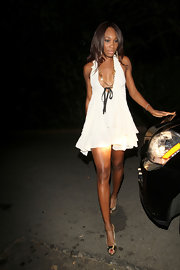 Venus highlighted her gorgeous skin tone with a white halter dress and metallic, peep toe pumps.