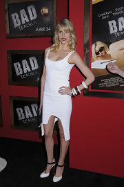 Lucy Punch wore black-and-white Christian Louboutin pumps with her white dress for a chic finish.