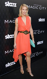 Kelly Lynch arrived at the Los Angeles premiere of 'Magic City' wearing a pair of sexy metallic gold peep toe sandals.