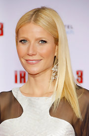 Gwyneth Paltrow still manages to rock her signature 'do: a center part and long sleek locks.