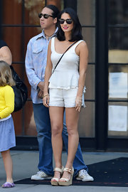 Olivia Munn chose a classic summery outfit when she wore this white peplum top with matching short shorts.