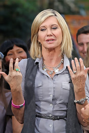 Olivia Newton-John wore a couple of lovely charm necklaces at a guesting for 'Extra.'