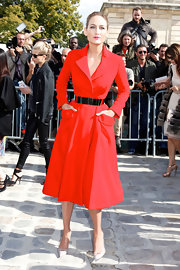 Leelee Sobieski was Dior perfection in this lipstick red coat dress and metallic belt.