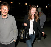 Olivia Wilde kept it casual carrying a studded black leather tote.