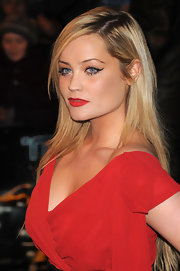 Laura Whitmore paired her sultry red lips with perfectly lined cat eyes.
