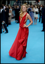 Kimberley was a vision in red in this strappy-shouldered draped gown.