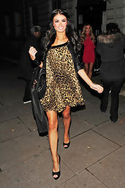 Chloe Sims donned a leopard print dress while out and about in London.