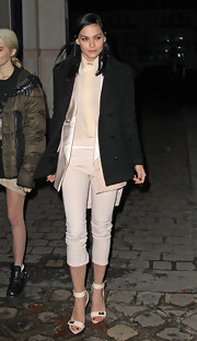 Leigh donned simple accessories, opting for nude strappy sandals.