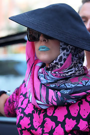 Lady Gaga chose to wear an icy blue shade of lipstick while out and about in NYC. The creamy, full-coverage formulation had a satin finish with just a hint of shine. To try her look, M.A.C. Paint Stick in a color like Cyan applied under a coat of clear gloss works well.