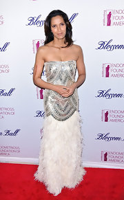 Padma Lakshmi donned this strapless silver dress with a feathered skirt to the Blossom Ball.