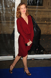 Eva Herzigova wore a beautifully draped red knit dress for the 'Totem' show.