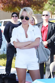 Pamela Anderson was all attitude in a pair of super-short cuffed chino shorts.