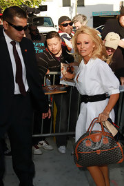 Pamela heads into the Larry King live studios dressed in her favorite color. She topped her white classic dress off with a printed tote bag.