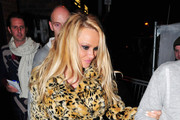 Pamela Anderson keeps cosy in faux fur as she attends Paul McCartney's concert at the O2 Academy in Liverpool.