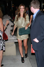 Audrina Patridge accented her glitzy gold dress with an oversize forest green clutch.