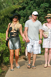 Paris wears a stylish one-piece swim suit with unique cut outs for her Christmas vacation in Maui.
