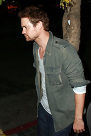 Shane West looked rugged and casual in an unbuttoned gray denim shirt.