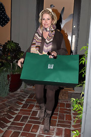 Kathy Hilton went shopping with her daughters in taupe suede lace up boots. She paired the boots with brown opaque tights.