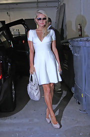 Paris looked glamorous as ever in this white fit-and-flare dress with shoulder cutouts.