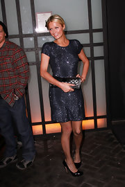 Paris Hilton accented her sequined dress with a metallic pewter checkerboard clutch.
