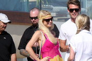 Paris Hilton rocks a vibrant silk maxi dress as she hosts a beach party at her Malibu beach house.  The reality star, who was rocking an oversized crystal teddy bear charm on her hot pink Chanel bag, was all smiles as she chatted with guests down on the beach. Her sister Nicky Hilton was in attendance - helping her sibling's party go with a swing.