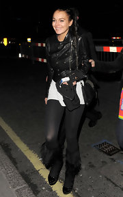 Lindsay Lo sure does love her leather. She wore a military style leather jacket and paired it with an edgy chain strap leather studded bag. Biker chic!