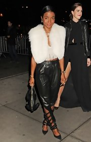 Genevieve Jones wore trendy pleated waist leather pants with unique cut-outs at the calf.