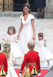 Pippa Middleton looked lovely as she walked down the isle in a stunning Alexander McQueen dress. She styled her hair in a half up hairstyle with flowing curls.