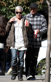 Pink kept her look low key in multi-buckle boots while out with husband Carey Hart.