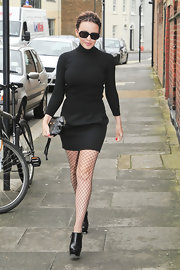 Kylie Minogue was out and about London town in chic black leather ankle boots.