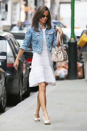 Pippa Middleton donned a pair of comfortable white wedges as she strolled through Chelsea.