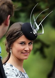 Pippa Middleton chose a delicate topper with silver-feather and pearl detailing for Melissa Percy's wedding.