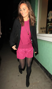 Pippa Middleton went clubbing in pink silk shorts over black tights.
