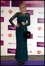 Pixie Lott complemented her dress with a classic black chain-strap bag.