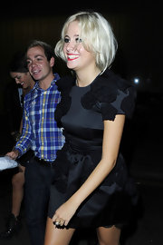 Pixie Lott showed off her funky style in a rose embellished cocktail dress.