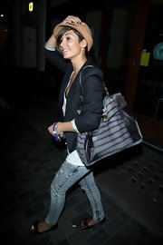 Frankie Sandford toted an exotic striped two-tone snakeskin bag to Movida nightclub.