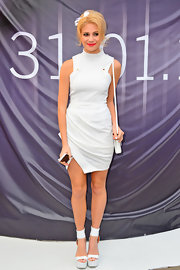 How cute is Pixie Lott in this white twist dress with a mod top and mock-neck collar?