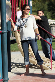 Alessandra Ambrosio maintained her boho-chic style at the park in a tie-dye top and rolled jeans.