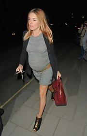 Sienna Miller was spotted leaving Claridges in London wearing a pair of black and gold ankle boots.