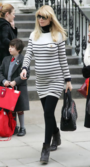 Claudia is darling in Breton stripes as she picks up her kids from school