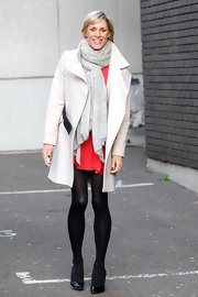Jenni braved a chilly day in London in this classy cream wool coat.
