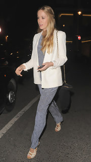 Florence Brudenell-Bruce topped off her evening look with this retro-inspired white blazer.