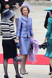 Queen Sofia showed off her knack for royal style in a lilac skirt suit with flower embellishments down the center.