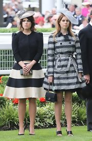 Princess Eugenie wore a black puffed-shoulder jacket over her striped dress at the Royal Ascot's Opening Day.